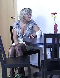 The hot girlfriend eats his mom's pussy as they hang out in the kitchen together
