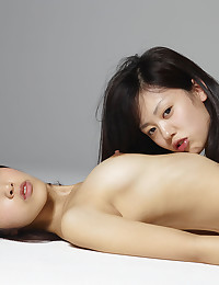 Two hot lesbian Asian babes go down on each other.