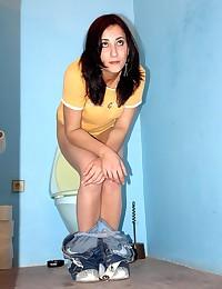 Hot chick fucking through a public toilethole