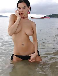 Katie Fey - On the beach in her bikini bottoms showing big hot titties