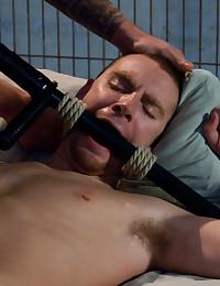 Christian Wilde in police uniform captures and fucks Sebastian Keys in bondage.