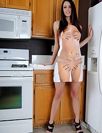 Semi-nude girl in the kitchen