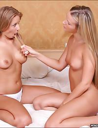 Two platinum blonde teens sha...