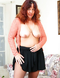 Naked mature in ripped pantyhose