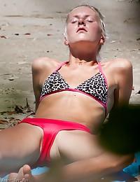 A tempting barefaced bikini on a beach