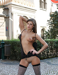 Maria is looking hot in her black dress and leopard print stockings.