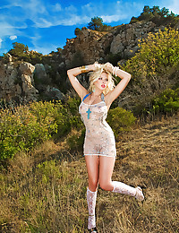 Euro beauty outdoors in a stunning location to show off her titties