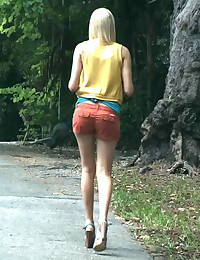 We were riding through the Grove and from afar we see this hot blonde, Tara Lee, walking and talking to some peacocks that were chilling beside her.