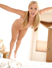 Young blonde angel poses in h...