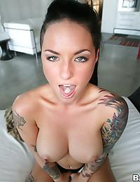 Tattooed Hottie Sucks Hard Cock