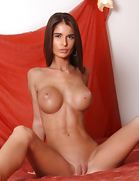Nessa A puts her big jugs on display for us.