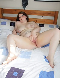 Tattooed BBW solo striptease