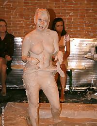 Topless mud wrestling