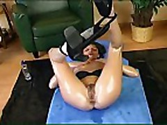 Oiled brunette masturbating and fisting both ways