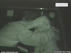 Inside Of Dark Car, A Man Was Over A Woman On The Seat