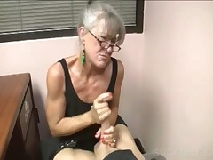Horny Mommy In Glasses Rubbing Big Phallus