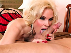 Busty blonde MILF gets a hold of a big cock to suck and fuck