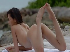Exotic beauty undressing on the beach