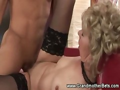 Stockinged granny gets nailed with cock