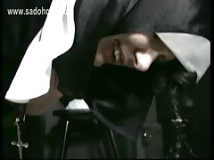 Horny nun with her skirt up lying on knee of priest is hit on her ass with whip and hand