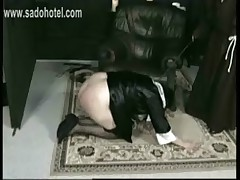 Nun lying on the ground with her dress up is spanked on her ass by angry priest