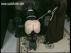 Horny nun slave is bend over a chair by a priest and spanked hard on her big ass