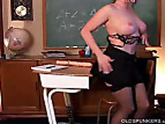 Sexy MILF in stockings fucks huge dildo