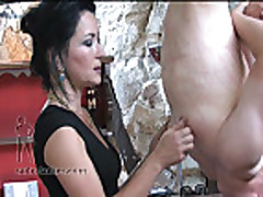 domme in boots scratching slave with her sharp fingernails