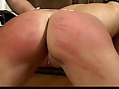 mistress in boots spanks her slave girl