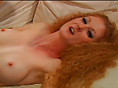 Hairy and busty redhead mature
