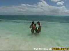 Two bikini models group beach sex